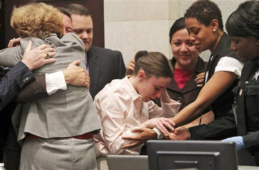 Casey Anthony, center, is overcome with as her lawyers, Jose Baez hugs Dorothy Clay Sims, left, after she was acquitted of murder charges in Orlando, Fla., Tuesday, July 5, 2011. Anthony has been charged with klling her daughter, Caylee. &#40;AP Photo&#47;Red Huber, Pool&#41; <span class=meta>(AP Photo&#47; Red Huber)</span>