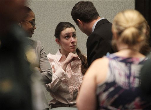 "<div class=""meta ""><span class=""caption-text "">Casey Anthony talks with a supporter in court following the end of her  murder trial where she was acquitted of murder charges in  Orlando, Fla. Tuesday, July 5, 2011. Anthony had been charged with killing her daughter, Caylee.  (AP Photo/Red Huber, Pool) (AP Photo/ Red Huber)</span></div>"