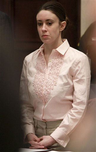 Casey Anthony stands for the arrival of the jury at the start of the second day of jury deliberations in her murder trial at the Orange County Courthouse in Orlando, Fla., Tuesday, July 5, 2011. Anthony has plead not guilty to first-degree murder in the death of her daughter, Caylee, and could face the death penalty if convicted of that charge. &#40;AP Photo&#47;Joe Burbank, Pool&#41; <span class=meta>(AP Photo&#47; Joe Burbank)</span>