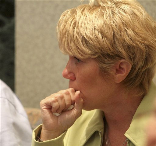 "<div class=""meta ""><span class=""caption-text "">Cindy Anthony waits in the courtroom after an announcement that there is a verdict in the murder trial of her daughter, Casey Anthony, at the Orange County Courthouse in Orlando, Fla., Tuesday,  July 5, 2011.  (AP Photo/Red Huber, Pool) (AP Photo/ Red Huber)</span></div>"