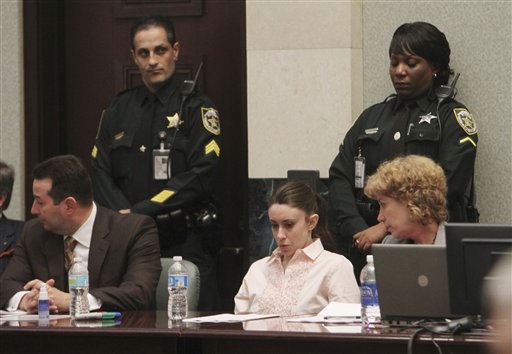 "<div class=""meta image-caption""><div class=""origin-logo origin-image ""><span></span></div><span class=""caption-text"">Casey Anthony, center, sits at the defense table, with her attorneys, Jose Baez, left, and Dorothy Clay Sims waiting for the jury to return with the verdict in her murder trial at the Orange County Courthouse in Orlando, Fla., Tuesday, July 5, 2011. The jury acquitted Anthony of mudering her daughter, Caylee.  (AP Photo/Red Huber, Pool) (AP Photo/ Red Huber)</span></div>"