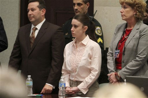 Casey Anthony, center, with her attorneys Jose Baez, left, and Dorothy Clay Sims, right, stand before the jury presents a verdict in her murder murder trial at the Orange County Courthouse Orlando, Fla., Tuesday,  July 5, 2011. The jury acquitted Casey Anthony of murdering her daughter Caylee. &#40;AP Photo&#47;Red Huber, Pool&#41; <span class=meta>(AP Photo&#47; Red Huber)</span>