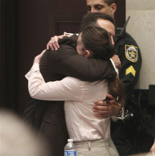 Defense attorney Jose Baez hugs his client, Casey Anthony, after the jury acquitted her of murdering her daughter, Caylee, during Anthony&#39;s murder trial at the Orange County Courthouse in Orlando, Fla., Tuesday, July 5, 2011. &#40;AP Photo&#47;Red Huber, Pool&#41; <span class=meta>(AP Photo&#47; Red Huber)</span>