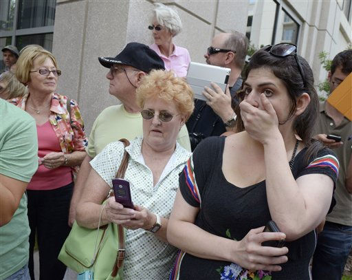 Jenn Keller, right, reacts after the Casey Anthony not guilty verdict was announced outside the Orange County Courthouse in Orlando, Fla., Tuesday, July 5, 2011.&#40;AP Photo&#47;Phelan M. Ebenhack&#41; <span class=meta>(AP Photo&#47; Phelan M. Ebenhack)</span>