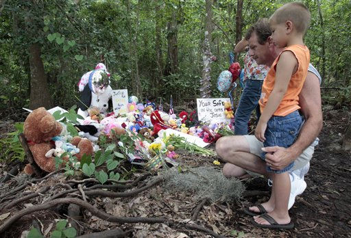 Alan Holt and his grandson Mark Likins, of Thomasville, Ga., visit the memorial of Caylee Anthony before Casey Anthony was found not guilty of first-degree murder, aggravated manslaughter and aggravated child abuse. in Orlando, Fla., Tuesday, July 5, 2011. &#40;AP Photo&#47;Alan Diaz&#41; <span class=meta>(AP Photo&#47; Alan Diaz)</span>