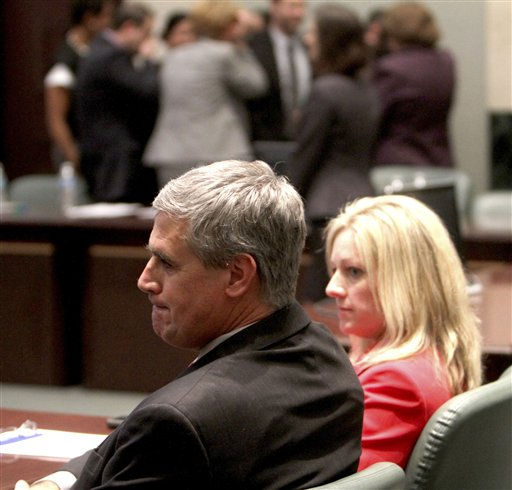 Assistant state attorneys Jeff Ashton and Linda Drane Burdick sit at the prosecution table as the Casey Anthony defense team celebrates in the background following her acquittal on murder charges at the Orange County Courthouse Orlando, Fla. on July 5, 2011. Anthony had been charged with killing her daughter, Caylee. &#40;AP Photo&#47;Red Huber, Pool&#41; <span class=meta>(AP Photo&#47; Red Huber)</span>