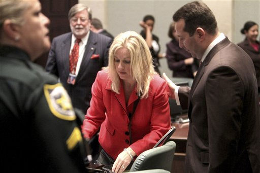 "<div class=""meta ""><span class=""caption-text "">Defense attorney Jose Baez, right, talks with assistant state attorney Linda Drane Burdick following the  Casey Anthony murder trial at the Orange County Courthouse in Orlando, Fla., Tuesday,  July 5, 2011. Anthony had been charged with killing her daughter, Caylee. (AP Photo/Red Huber, Pool) (AP Photo/ Red Huber)</span></div>"