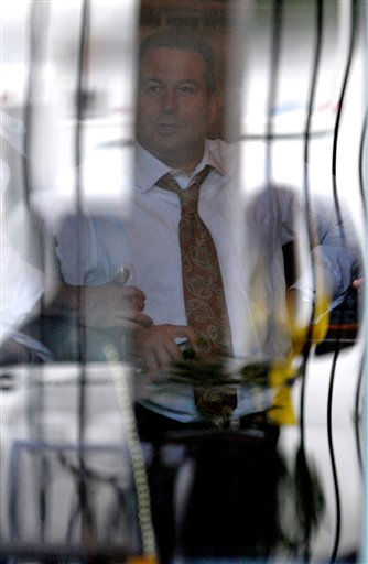 Casey Anthony lead defense attorney Jose Baez, center, is seen through a window participating in a celebration with other members of his defense team and staff at a restaurant across the street from the Orange County Courthouse after the not-guilty verdict was announced in Orlando, Fla., Tuesday, July 5, 2011. &#40;AP Photo&#47;Phelan M. Ebenhack&#41; <span class=meta>(AP Photo&#47; Phelan M. Ebenhack)</span>