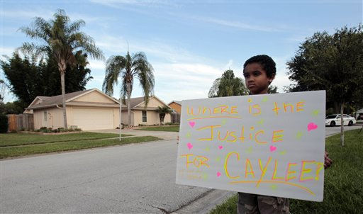 Isaiah James McCoy, 7, holds a sign if front of George and Cindy Anthony&#39;s home, background left, in Orlando, Fla., Tuesday, July 5, 2011.  Casey Anthony was found not guilty of first-degree murder, aggravated manslaughter and aggravated child abuse. &#40;AP Photo&#47;Alan Diaz&#41; <span class=meta>(AP Photo&#47; Alan Diaz)</span>