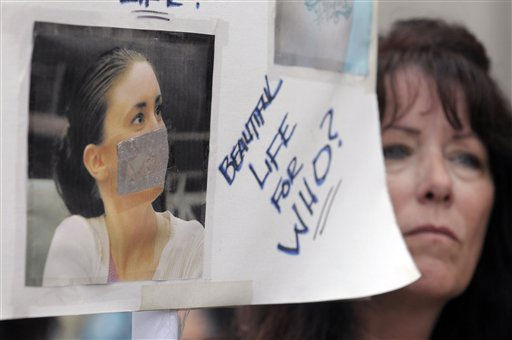 Lori Richards, right, of Daytona Beach, Fla., protests outside the Orange County Courthouse during the sentencing hearing for Casey Anthony in Orlando, Fla., Thursday, July 7, 2011.  Judge Belvin Perry sentenced  Anthony to four years for lying to investigators but says she can go free in late July or early August because she has already served nearly three years in jail and has had good behavior. While acquitted of killing and abusing her 2-year-old daughter Caylee, Anthony was convicted of four counts of lying to detectives trying to find her daughter in July 2008. &#40;AP Photo&#47;Phelan M. Ebenhack&#41; <span class=meta>(AP Photo&#47; Phelan M. Ebenhack)</span>