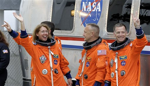 "<div class=""meta image-caption""><div class=""origin-logo origin-image ""><span></span></div><span class=""caption-text"">The space shuttle Atlantis astronauts left to right, mission specialists Rex Walheim, Sandy Magnus, pilot Doug Hurley and commander Chris Ferguson, leave the operations and check-out building on the way to the pad at the Kennedy Space Center Friday, July 8, 2011, in Cape Canaveral, Fla. Atlantis is the 135th and final space shuttle launch for NASA. (AP Photo/Terry Renna) (AP Photo/ Terry Renna)</span></div>"