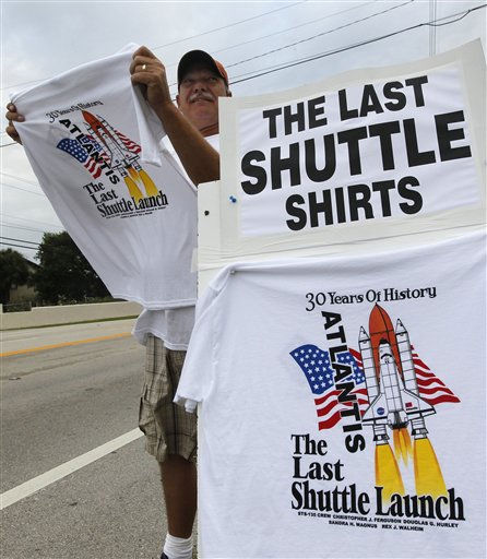 "<div class=""meta image-caption""><div class=""origin-logo origin-image ""><span></span></div><span class=""caption-text"">Jeff Eaton of Cocoa Beach, Fla., sells t-shirts along A1A in Cocoa Beach on Friday, July 8, 2011. Thousands headed to the Florida coast Friday morning, anxious for a good spot to view the final launch of space shuttle Atlantis.  (AP Photo/Dave Martin) (AP Photo/ Dave Martin)</span></div>"