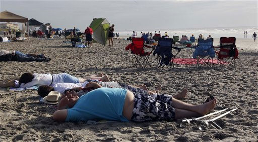 People sleep on the beach in Cocoa Beach on Friday, July 8, 2011. Thousands headed to the Florida coast Friday morning, anxious for a good spot to view the final launch of space shuttle Atlantis.  &#40;AP Photo&#47;Dave Martin&#41; <span class=meta>(AP Photo&#47; Dave Martin)</span>