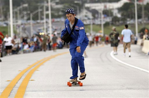 Reid Goodfellow, 16, of Atlanta, rides his skateboard on the Max Brewer Bridge dressed as an astronaut as he waits for the launch of space shuttle Atlantis Friday, July 8, 2011, in Titusville, Fla. Atlantis is scheduled to liftoff Friday on the final space shuttle mission. &#40;AP Photo&#47;David J. Phillip&#41; <span class=meta>(AP Photo&#47; David J. Phillip)</span>