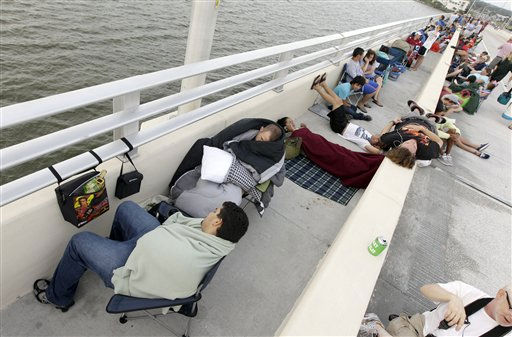 Spectators wait along the Max Brewer Bridge for the launch of space shuttle Atlantis Friday, July 8, 2011, in Titusville, Fla. Atlantis is scheduled to liftoff Friday on the final space shuttle mission. &#40;AP Photo&#47;David J. Phillip&#41; <span class=meta>(AP Photo&#47; David J. Phillip)</span>