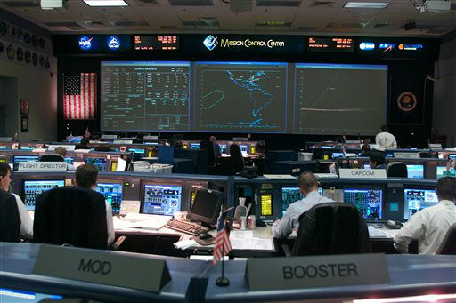 This Jan. 16, 2003 picture made available by NASA shows an overall view of the shuttle flight control room in Houston&#39;s Mission Control Center &#40;MCC&#41;. At the time this photo was taken the Space Shuttle Columbia was about to launch at the Kennedy Space Center, Florida. Once the vehicle cleared the tower in Florida, the Houston-based team of flight controllers took over the ground control of the STS-107 flight. &#40;AP Photo&#47;NASA&#41; <span class=meta>(AP Photo&#47; Anonymous)</span>