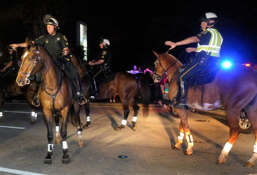 Mounted officers from the Orange County Sheriff&#39;s Department moves protestors off the street as Casey Anthony was released from the Orange County Jail in Orlando, Fla., Sunday, July 17, 2011.&#40;AP Photo&#47;Phelan M. Ebenhack&#41; <span class=meta>(AP Photo&#47; Phelan M. Ebenhack)</span>