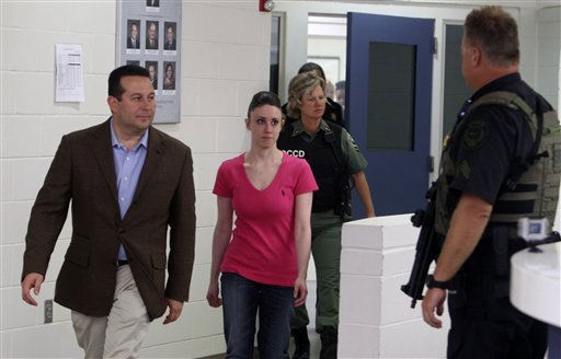 "<div class=""meta ""><span class=""caption-text "">Casey Anthony, center, walks out of the Orange County Jail with her attorney Jose Baez, left,  during her release in Orlando, Fla., early Sunday, July 17, 2011.  Anthony was acquitted last week of murder in the death of her daughter, Caylee. (AP Photo/Red Huber, Pool) (AP Photo/ Red Huber)</span></div>"
