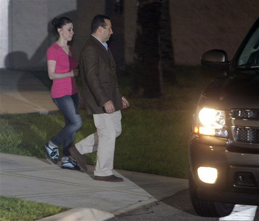 Casey Anthony, left, walks to a SUV with her lawyer Jose Baez after she was released from the Orange County Jail in Orlando, Fla., early Sunday, July 17, 2011.  Anthony was acquitted last week of murder in the death of her daughter, Caylee. &#40;AP Photo&#47;John Raoux&#41; <span class=meta>(AP Photo&#47; John Raoux)</span>
