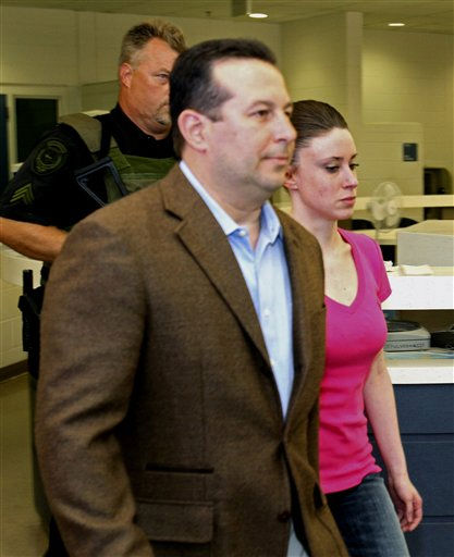 "<div class=""meta ""><span class=""caption-text "">Casey Anthony, front right, walks out of the Orange County Jail with her attorney Jose Baez, left,  during her release in Orlando, Fla., Sunday, July 17, 2011.  Anthony was acquitted last week of murder in the death of her daughter, Caylee. (AP Photo/Red Huber,Pool) (AP Photo/ Red Huber)</span></div>"