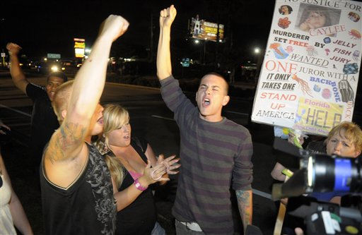 Protestors show their displeasure after Casey Anthony was released from the Orange County Jail in Orlando, Fla., early Sunday, July 17, 2011.&#40;AP Photo&#47;Phelan M. Ebenhack&#41; <span class=meta>(AP Photo&#47; Phelan M. Ebenhack)</span>
