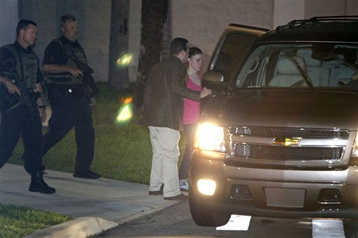 Casey Anthony, right, gets in an SUV with her lawyer Jose Baez, center, as she is escorted by Orange County Sheriff deputies after her release from the Orange County Jail in Orlando, Fla., early Sunday, July 17, 2011.  Anthony was acquitted last week of murder in the death of her daughter, Caylee. &#40;AP Photo&#47;John Raoux&#41; <span class=meta>(AP Photo&#47; John Raoux)</span>