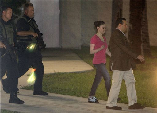 "<div class=""meta ""><span class=""caption-text "">Casey Anthony, second from right, leaves the Orange County Jail with her lawyer Jose Baez, right, as she is escorted by Orange County Sheriff deputies after her release in Orlando, Fla., early Sunday, July 17, 2011.  Anthony was acquitted last week of murder in the death of her daughter, Caylee. (AP Photo/John Raoux) (AP Photo/ John Raoux)</span></div>"