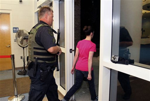 "<div class=""meta ""><span class=""caption-text "">Casey Anthony, right, walks out of the Orange County Jail escorted by a sheriff's deputy  during her release in Orlando, Fla., early Sunday, July 17, 2011.  Anthony was acquitted last week of murder in the death of her daughter, Caylee. (AP Photo/Red Huber, Pool) (AP Photo/ Red Huber)</span></div>"