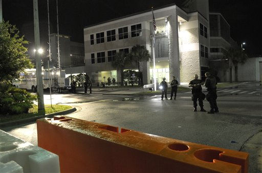 Orange County police officers stand guard, as barricades block the street entrance, outside the Booking and Release Center of the Orange County Jail in preparation for the release of Casey Anthony in Orlando, Fla., Saturday, July 16, 2011.&#40;AP Photo&#47;Phelan M. Ebenhack&#41; <span class=meta>(AP Photo&#47; Phelan M. Ebenhack)</span>