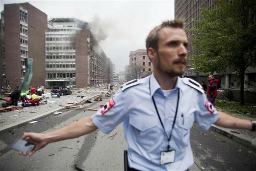 "<div class=""meta ""><span class=""caption-text "">CORRECTS YEAR  An official attempts to clear away spectators from buildings in the centre of Oslo, Friday July 22, 2011, following an explosion that tore open several buildings including the prime minister's office, shattering windows and covering the street with documents.(AP Photo/Fartein Rudjord) NORWAY OUT: (AP Photo/ Fartein Rudjord)</span></div>"