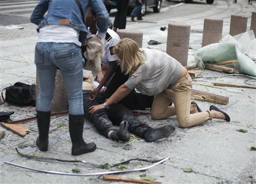 "<div class=""meta image-caption""><div class=""origin-logo origin-image ""><span></span></div><span class=""caption-text"">CORRECTS YEAR  A victim is treated outside government buildings in the centre of Oslo, Friday July 22, 2011, following an explosion that tore open several buildings including the prime minister's office, shattering windows and covering the street with documents.(AP Photo/Fartein Rudjord) NORWAY OUT: (AP Photo/ Fartein Rudjord)</span></div>"