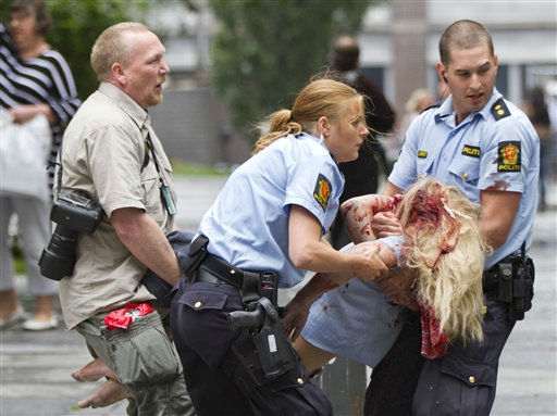 CORRECTS YEAR  A young victim is helped in the centre of Oslo, Friday July 22, 2011, following an explosion that tore open several buildings including the prime minister&#39;s office, shattering windows and covering the street with documents.&#40;AP Photo&#47;Winje ?jijord, Scanpix Norway&#41; NORWAY OUT: <span class=meta>(AP Photo&#47; Winje ?ijord)</span>