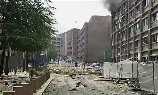 In this video image taken from television, smoke is seen billowing from a damaged building as debris is strewn across the street after an explosion in Oslo, Norway Friday July 22, 2011. A loud explosion shattered windows Friday at the government headquarters in Oslo which includes the prime minister&#39;s office, injuring several people. Prime Minister Jens Stoltenberg is safe, government spokeswoman Camilla Ryste told The Associated Press.   &#40;AP Photo&#47;TV2 NORWAY via APTN&#41;   NORWAY OUT <span class=meta>(AP Photo&#47; Anonymous)</span>