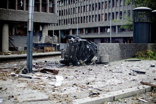 The wreckage of a car lies outside government buildings in the center of Oslo, Friday July 22, 2010, following an explosion that tore open several buildings including the prime minister&#39;s office, shattering windows and covering the street with documents.&#40;AP Photo&#47;Fartein Rudjord&#41; NORWAY OUT: <span class=meta>(AP Photo&#47; Fartein Rudjord)</span>