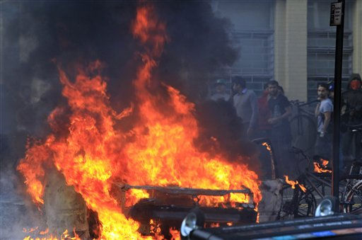 "<div class=""meta ""><span class=""caption-text "">A car set on fire by rioters burns in Hackney, east London, Monday, Aug. 8, 2011. Violence and looting spread across some of London's most impoverished neighborhoods on Monday, with youths setting fire to shops and vehicles, during a third day of rioting in the city that will host next summer's Olympic Games. (AP Photo/Lefteris Pitarakis) (AP Photo/ Lefteris Pitarakis)</span></div>"