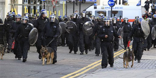 British police officers charge rioters, during riots in Hackney, east London, Monday Aug. 8, 2011.  Youths set fire to shops and vehicles in a host of areas of London _ which will host next summer&#39;s Olympic Games _ and clashed with police in the nation&#39;s central city of Birmingham, as authorities struggled to halt groups of rampaging young people. &#40;AP Photo&#47;Lefteris Pitarakis&#41; <span class=meta>(AP Photo&#47; Lefteris Pitarakis)</span>