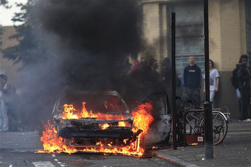 "<div class=""meta ""><span class=""caption-text "">A car burns after it was set on fire by rioters in Hackney, east London, Monday Aug. 8, 2011. Youths set fire to shops and vehicles in a host of areas of London _ which will host next summer's Olympic Games _ and clashed with police in the nation's central city of Birmingham, as authorities struggled to halt groups of rampaging young people. (AP Photo/Lefteris Pitarakis) (AP Photo/ Lefteris Pitarakis)</span></div>"