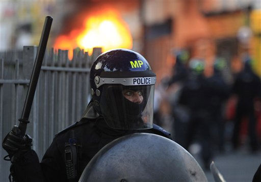 "<div class=""meta ""><span class=""caption-text "">British police officers are deployed during riots in Hackney, east London, Monday Aug. 8, 2011. Youths set fire to shops and vehicles in a host of areas of London _ which will host next summer's Olympic Games _ and clashed with police in the nation's central city of Birmingham, as authorities struggled to halt groups of rampaging young people. (AP Photo/Lefteris Pitarakis) (AP Photo/ Lefteris Pitarakis)</span></div>"
