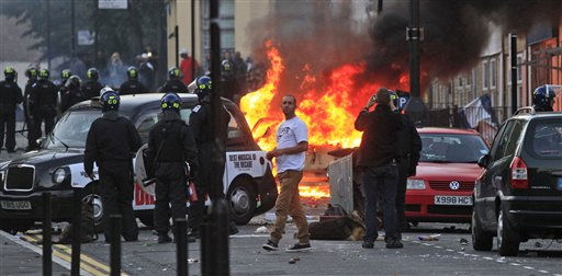 "<div class=""meta image-caption""><div class=""origin-logo origin-image ""><span></span></div><span class=""caption-text"">British police officers charge rioters, during riots in Hackney, east London, Monday Aug. 8, 2011. Youths set fire to shops and vehicles in a host of areas of London _ which will host next summer's Olympic Games _ and clashed with police in the nation's central city of Birmingham, as authorities struggled to halt groups of rampaging young people. (AP Photo/Lefteris Pitarakis) (AP Photo/ Lefteris Pitarakis)</span></div>"
