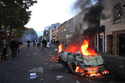 A car burns after it was set on fire by rioters in Hackney, east London, Monday Aug. 8, 2011. Youths set fire to shops and vehicles in a host of areas of London _ which will host next summer&#39;s Olympic Games _ and clashed with police in the nation&#39;s central city of Birmingham, as authorities struggled to halt groups of rampaging young people. &#40;AP Photo&#47;Lefteris Pitarakis&#41; <span class=meta>(AP Photo&#47; Lefteris Pitarakis)</span>