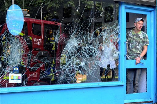 "<div class=""meta ""><span class=""caption-text "">Shop keepers begin to clean up on Ealing High Street, west London following a third straight of disturbances on the streets of London Tuesday Aug. 9, 2011. A wave of violence and looting raged across London and spread to three other major British cities Tuesday, as authorities struggled to contain the country's worst unrest since race riots set the capital ablaze in the 1980s.   (AP Photo/Anthony Devlin/PA Wire)   UNITED KINGDOM OUT NO SALES NO ARCHIVE (AP Photo/ Anthony Devlin)</span></div>"