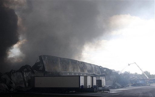 "<div class=""meta image-caption""><div class=""origin-logo origin-image ""><span></span></div><span class=""caption-text"">Smoke rises from a burning Sony distribution center reportedly set alight by rioters in Enfield, north London, Tuesday Aug. 9 2011.  A wave of violence and looting has raged across London since Saturday, as authorities struggled to contain the country's worst unrest since race riots set the capital ablaze in the 1980s.  Some 525 arrests have been made in London alone and dozens were arrested in other cities. Police announced Tuesday that plastic bullets would be ""one of the tactics"" available to officers to quell the riots.(AP Photo/Akira Suemori) (AP Photo/ Akira Suemori)</span></div>"
