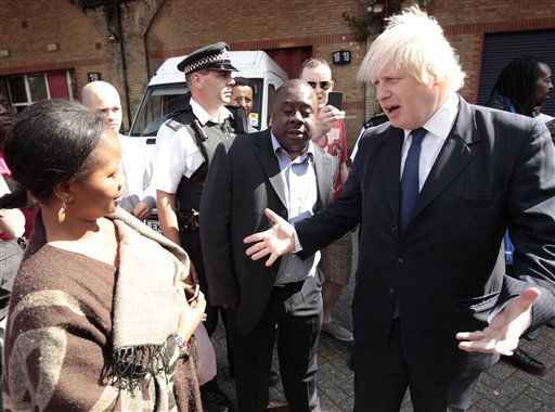 London Mayor Boris Johnson, right, talks with local residents during a visit to Clapham, south London, Tuesday Aug. 9, 2011, one of the areas affected by rioting. A wave of violence and looting has raged across London since Saturday, as authorities struggled to contain the country&#39;s worst unrest since race riots set the capital ablaze in the 1980s.  Some 525 arrests have been made in London alone and dozens were arrested in other cities. Police announced Tuesday that plastic bullets would be &#34;one of the tactics&#34; available to officers to quell the riots.&#40;AP Photo&#47;Matt Dunham&#41; <span class=meta>(AP Photo&#47; Matt Dunham)</span>