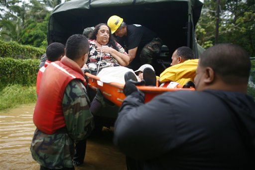 A woman is carried on a stretcher by civil defense workers after she was unable to attend a respiratory therapy due to an emphysema after hurricane Irene struck and flooded the area she lives in Naguabo, Puerto Rico, Monday, Aug. 22, 2011.   <span class=meta>(AP Photo&#47; Ricardo Arduengo)</span>