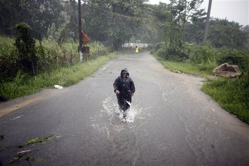 A man wades through a flooded street after hurricane Irene hit the area in Naguabo, Puerto Rico, Monday, Aug. 22, 2011. Hurricane Irene headed out over warm ocean water on a path that could take it to northeastern Dominican Republic and part of Haiti early Tuesday and to the U.S. mainland by the end of the week.   <span class=meta>(AP Photo&#47; Ricardo Arduengo)</span>
