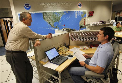 National Hurricane Center director Bill Read, left, talks with meteorologist Wallace Hogsett, Monday, Aug. 22, 2011 at the National Hurricane Center in Miami. As of the 5:00 p.m. advisory the center of Hurricane Irene was estimated to be near latitude 19.5 North, longitude 68.6 West, moving toward the West-Northwest near 13 MPH.   <span class=meta>(AP Photo&#47; Wilfredo Lee)</span>