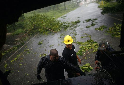 Civil defense workers prepare to remove debris from a road after hurricane Irene hit the area in Naguabo, Puerto Rico, Monday, Aug. 22, 2011. Hurricane Irene headed out over warm ocean water on a path that could take it to northeastern Dominican Republic and part of Haiti early Tuesday and to the U.S. mainland by the end of the week.   <span class=meta>(AP Photo&#47; Ricardo Arduengo)</span>