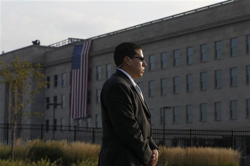 A U.S. Secret Service agent stands watch before the start of ceremonies for the 10th anniversary of the September 11 attacks are observed at the Pentagon in Washington, Sunday, Sept. 11, 2011.  <span class=meta>(AP Photo&#47; Charles Dharapak)</span>
