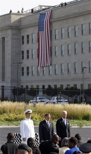 Chairman of the Joint Chiefs of Staff Adm. Mike Mullen, from left, Defense Secretary Leon Panetta, and Vice President Joe Biden stand during the playing of the National Anthem on the 10th anniversary of the September 11 attacks at the Pentagon in Washington, Sunday, Sept. 11, 2011.   <span class=meta>(AP Photo&#47; Charles Dharapak)</span>