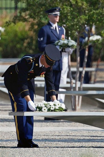 Soldiers lay wreaths at the Pentagon Memorial for each Sept. 11 victim on the benches bearing their names during the observance 10th anniversary of the September 11 attacks at the Pentagon in Washington, Sunday, Sept. 11, 2011.  <span class=meta>(AP Photo&#47; Charles Dharapak)</span>